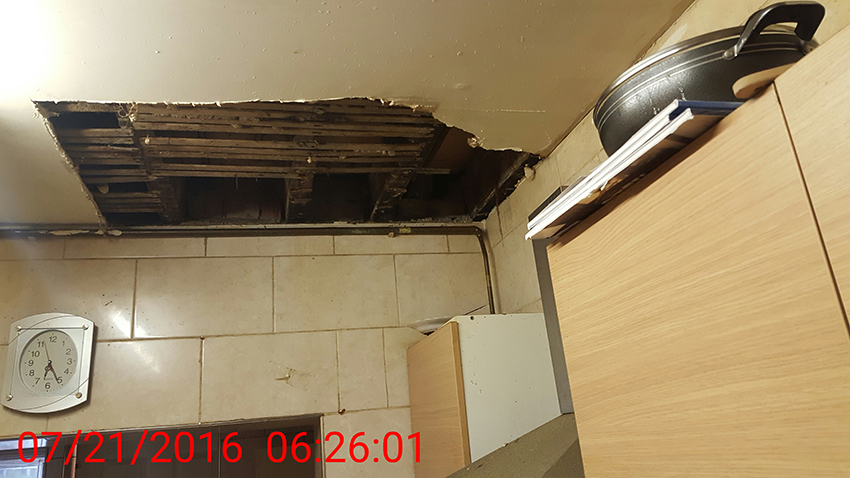 Brent Council housing raid - hole in ceiling - 2016